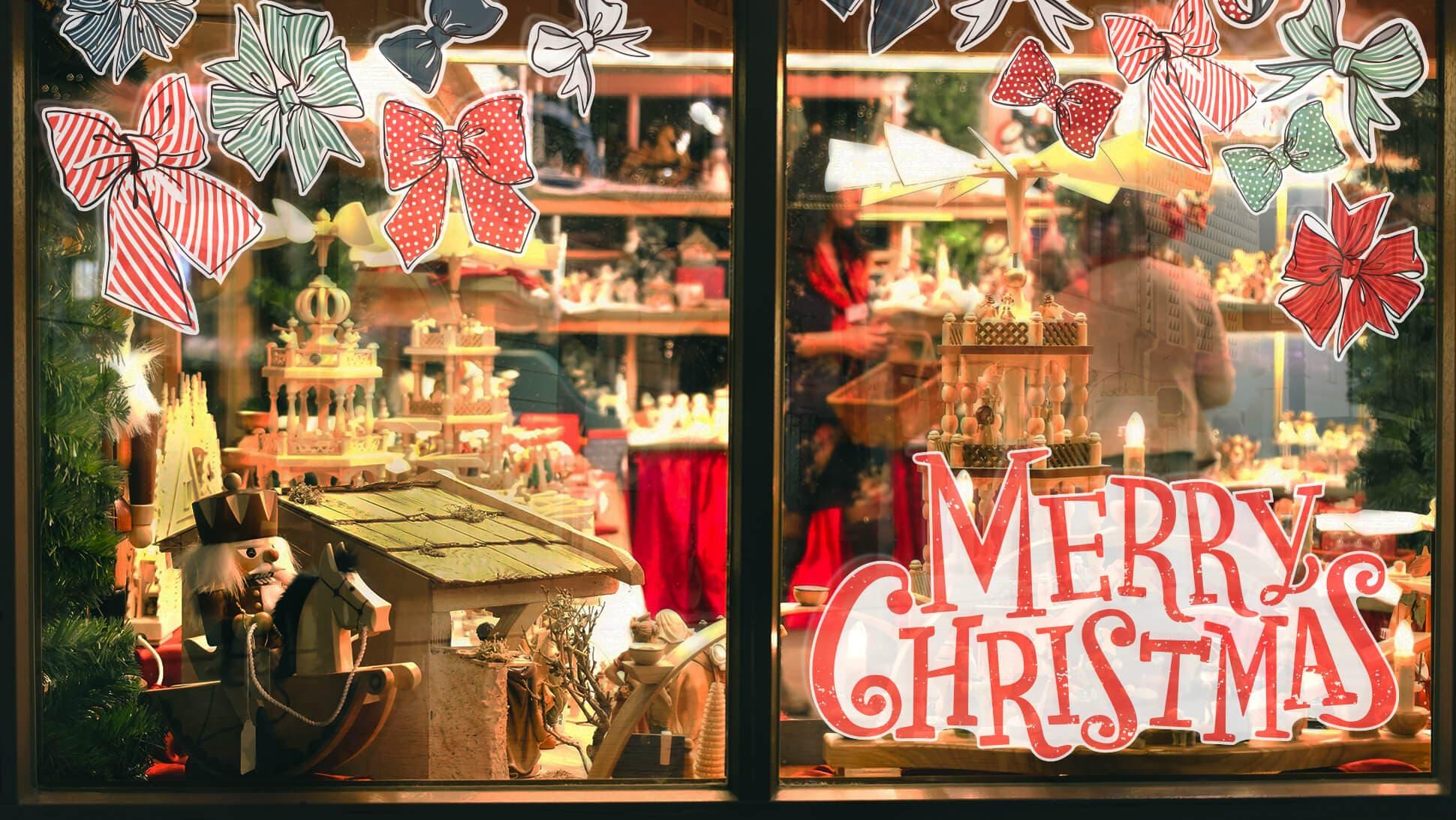adesivi natalizi per vetrine Merry Christmas con fiocchi | tictac.it